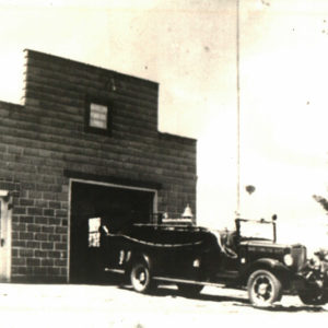 The 1935 1-1/2 ton truck in front of the fire station.