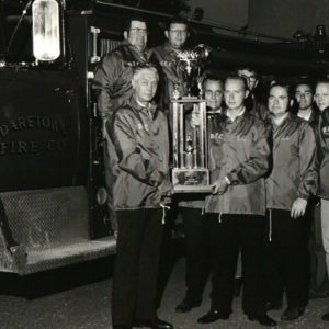 1973 - DFC Members won big at the 50th anniversary Salem County Firemen's Association Parade in Pennsgrove in 1973. Receiving the trophy for the best appearing pumper under 1000 gallons.  Holding the trophy are Chief Joe Layman and Assistant Chief Kenny Wilson, other members pictured include Jack Robinson, Kenny Patrick, Herbert Wentzell, Paul Smith, Leroy Richman, Scott Jess, Joe Newkirk, and Bill Crispin.